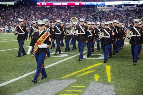 Gunnery Sgt. Stacie D. Crowther, drum major for Marine Corps Band New Orleans, leads the band off the field after their half-time performance at the New England Patriots game against the Seattle Seahawks at Gillette Stadium, Nov. 13, 2016. The band performed a Centennial concert to commemorate the 100th anniversary of the Marine Corps Reserve. From World War I through the wars in Iraq and Afghanistan, the Marine Corps Reserve has played an essential role in the Marine Corps Total Force by augmenting and reinforcing the active component across the full range of military operations.