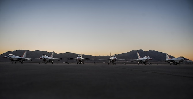 The U.S. Air Force Thunderbirds Air Demonstration Squadron's F-16s sit on the flightline at Nellis Air Force Base, Nev., before Aviation Nation, Nov. 11, 2016. The Air Force Thunderbirds demonstrate the capabilities of the Air Force and the decisive combat power Airmen bring to threats against the U.S. (U.S. Air Force photo by Airman 1st Class Kevin Tanenbaum/Released)
