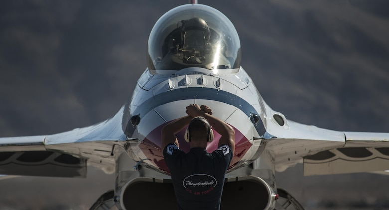 Members of the U.S. Air Force Thunderbirds Air Demonstration Squadron prepare for take-off during the Aviation Nation air show on Nellis Air Force Base, Nev., Nov. 11, 2016. The Thunderbirds perform precision aerial maneuvers demonstrating the capabilities of the Air Force's high-performance aircraft to people throughout the world. (U.S. Air Force photo by Airman 1st Class Kevin Tanenbaum/Released)