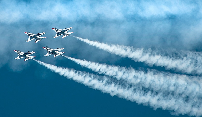 Four U.S. Air Force Thunderbirds Air Demonstration Squadron aircraft fly in a close-air formation during Aviation Nation on Nellis Air Force Base, Nev., Nov. 11, 2016. The Thunderbirds are a demonstration team who display the pride, precision and professionalism of American Airmen. (U.S. Air Force photo by Airman 1st Class Kevin Tanenbaum/Released)