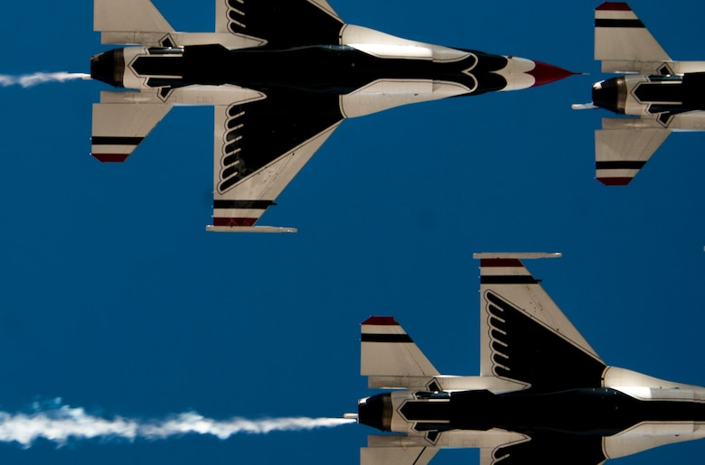 U.S. Air Force Thunderbird Air Demonstration Squadron  aircraft fly in a close-air formation during Aviation Nation on Nellis Air Force Base, Nev., Nov. 11, 2016. The Thunderbirds are the Air Force's demonstration team that showcase the decisive combat power, precision and professionalism of the aviators, maintenance and support Airmen. (U.S. Air Force photo by Airman 1st Class Kevin Tanenbaum/Released)