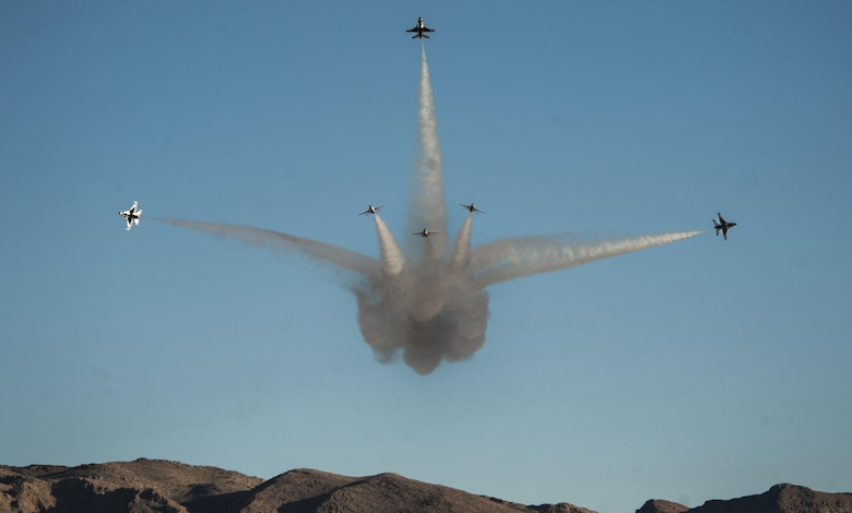 "The U.S. Air Force Thunderbirds Air Demonstration Squadron perform the bomb burst maneuver during the Aviation Nation air show on Nellis Air Force Base, Nev., Nov. 13, 2016. The air show brought more than 295,000 spectators from across the globe to experience ""75 Years of Air Power."" (U.S. Air Force photo by Airman 1st Class Kevin Tanenbaum/Released)"