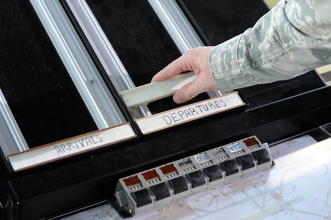 Senior Airman Erik Johnson, 5th Operations Support Squadron air traffic controller, annotates flight line discrepancy coordinates at the control tower on Minot Air Force Base, N.D., Nov. 15, 2016. Air traffic controllers operate air traffic systems to expedite and maintain a safe and orderly air traffic flow of all aircraft on base. (U.S. Air Force photo/Senior Airman Kristoffer Kaubisch)