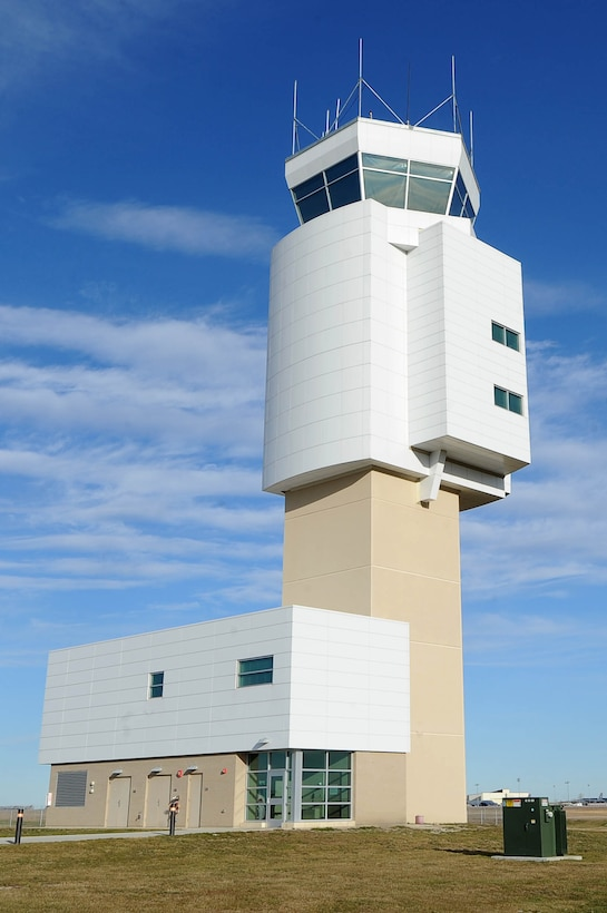 The air traffic control tower sits near the flight line at Minot Air Force Base, N.D., Nov. 15, 2016. Ensuring the safe flow of air traffic at Minot Air Force Base, N.D. is an essential component to securing the B-52H Stratofortresses'. Team Minot's ATC tower also supports air traffic for the 91st Missile Wing's UH-1N Hueys. (U.S. Air Force photo/Senior Airman Kristoffer Kaubisch)