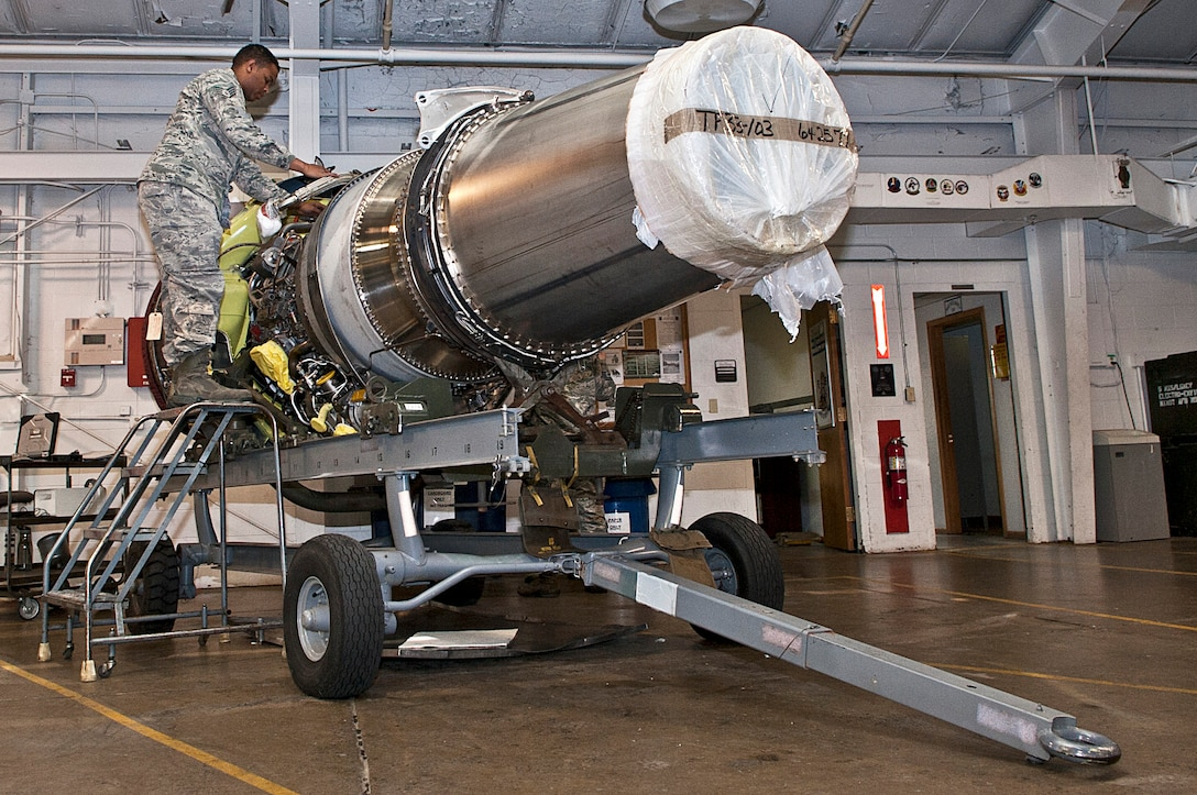 Staff Sgt. Korie Parker, 5th Maintenance Group maintenance operations flight engine trending and diagnostic monitor, inspects a B-52H Stratofortress engine at Minot Air Force Base, N.D., Nov. 15, 2016. These Airmen are responsible for checking all equipment received to ensure no damages occurred during shipment. (U.S. Air Force photo/Airman 1st Class Jonathan McElderry)