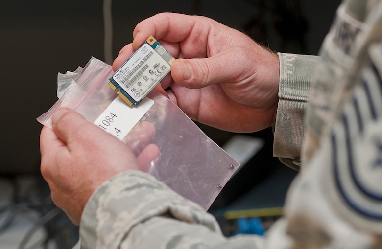 An Airman with the 5th Maintenance Group maintenance operations flight technical order distribution office checks a serial number at Minot Air Force Base, N.D., Nov. 15, 2016. Members of the distribution office track all maintenance operations flight equipment used for various jobs. (U.S. Air Force photo/Airman 1st Class Jonathan McElderry)