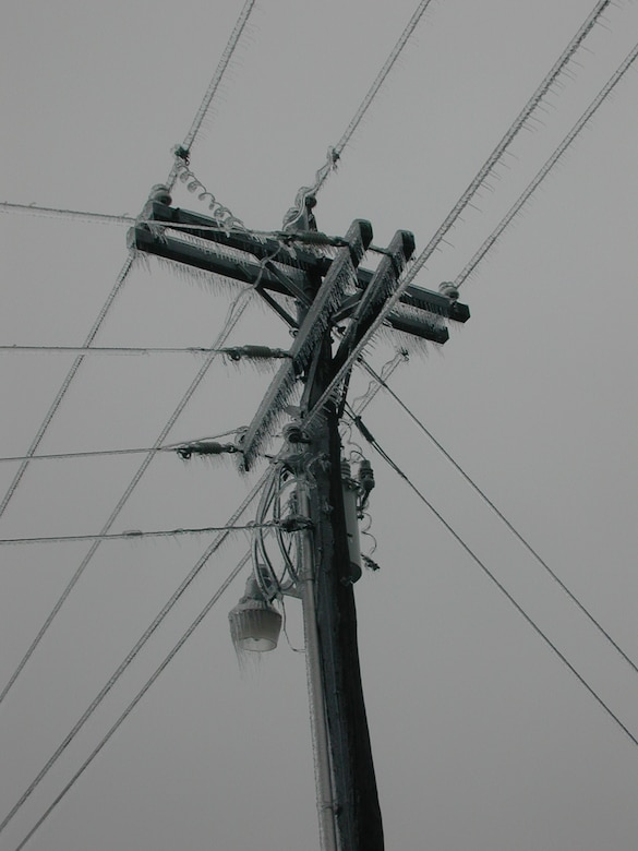 Glaze ice, formed by slow freezing rate, coating a utility pole.