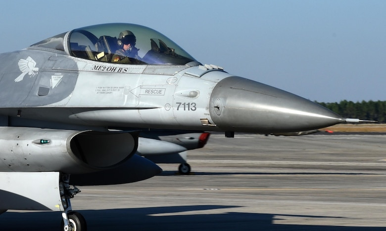A Singapore air force F-16 Fighting Falcon pilot from the 425th Fighter Squadron, Luke Air Force Base, Ariz., signals to his crew after a training exercise at Tyndall Air Force, Fla., Nov. 17, 2016. Singaporean pilots from Luke AFB and Mountain Home Air Force Base, Idaho, participated in the Weapons Systems Evaluation Program, which tests both U.S. and international pilots in real-time live-fire exercises to test the effectiveness of weapons in the Air Force arsenal. (U.S. Air Force photo Airman 1st Class Cody R. Miller/Released)