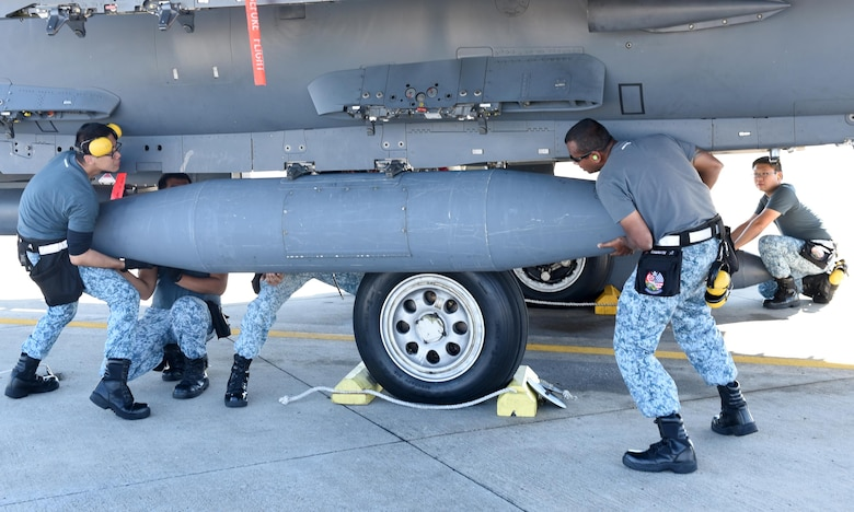 Singapore air force maintainers from the 428th Fighter Squadron, Mountain Home Air Force Base, Idaho, load fuel tanks onto an F-15 Eagle at Tyndall Air Force Base, Fla., Nov. 17, 2016. The Singapore air force took part in the Weapons Systems Evaluation program, an exercise intended to evaluate weapon systems in their entirety, including aircraft, weapon delivery system, weapon, aircrew, technical data and maintenance. (U.S. Air Force photo by Airman 1st Class Cody R. Miller/Released)