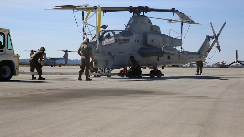 An AH-1Z Viper with Marine Light Attack Helicopter Squadron (HMLA) 267 is prepared to be transported on a C-17 Globemaster III aboard Marine Corps Air Station Miramar, Calif., Nov. 10. HMLA-267 deployed to MCAS Futenma, Okinawa, Japan, in November. (U.S. Marine Corps photo by Pfc. Liah Kitchen/Released)
