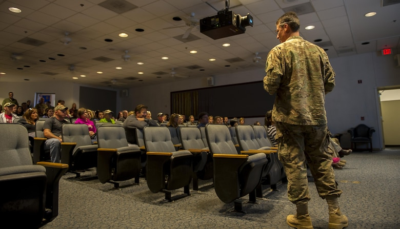 Col. Tom Palenske, commander of the 1st Special Operations Wing, briefs Air Commando spouses before a Spouses Flight tour at Hurlburt Field, Fla., Nov. 19, 2016. Spouses had the opportunity to fly in different 1st SOW aircraft including the AC-130J Ghostrider, CV-22 Osprey, AC-130U Spooky and U-28A. The event is designed to give spouses a better understanding of the importance of the 1st SOW mission. (U.S. Air Force photo by Airman 1st Class Isaac O. Guest IV)