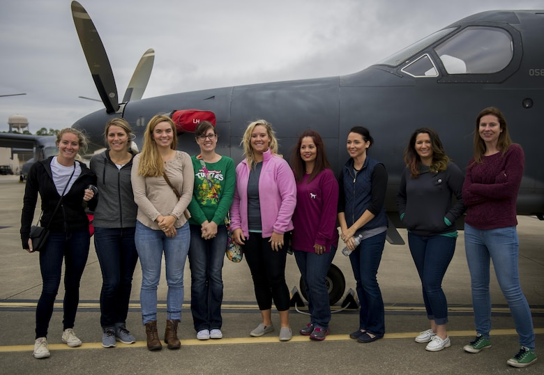 Air Commando spouses stand in front of a U-28A during a Spouses Flight tour at Hurlburt Field, Fla., Nov. 19, 2016. Spouse's toured static displays of different 1st Special Operations Wing aircraft to get a firsthand look at the capabilities of the 1st SOW. (U.S. Air Force photo by Airman 1st Class Isaac O. Guest IV)
