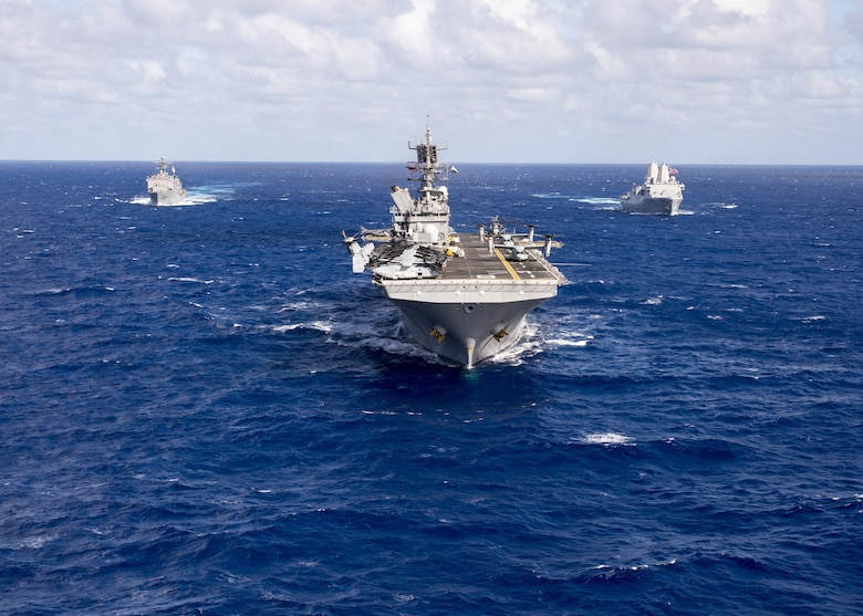 In this file photo, the Makin Island Amphibious Ready Group (ARG) underway in the western Pacific Ocean. The Makin Island ARG is comprised of the amphibious assault ship USS Makin Island (LHD 8), center, the amphibious dock landing ship USS Comstock (LSD 45), left, and the amphibious transport dock ship USS Somerset (LPD 25), Oct. 28, 2016. The ships are deployed with the embarked 11th Marine Expeditionary Unit in support of the Navy's maritime strategy in the U.S. 3rd Fleet area of responsibility.