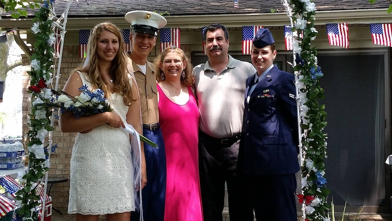 The Savino family pose for a picture together.