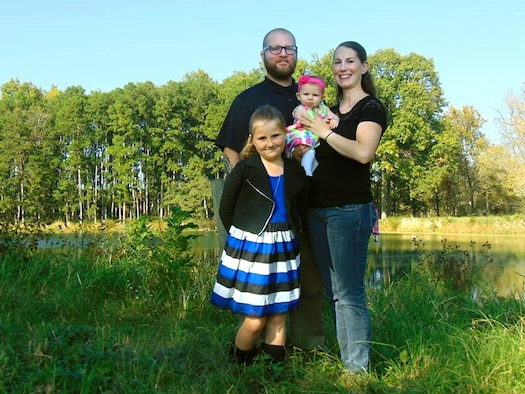 John and Staff Sgt. Shalon Sabo with their daughters Kayleigh, 8, and Avery, 5 months.