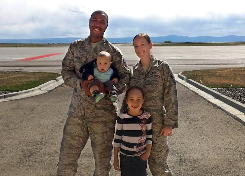 Master Sgt. Cortny Hughes, Master Sgt. Donald Hughes and their family.