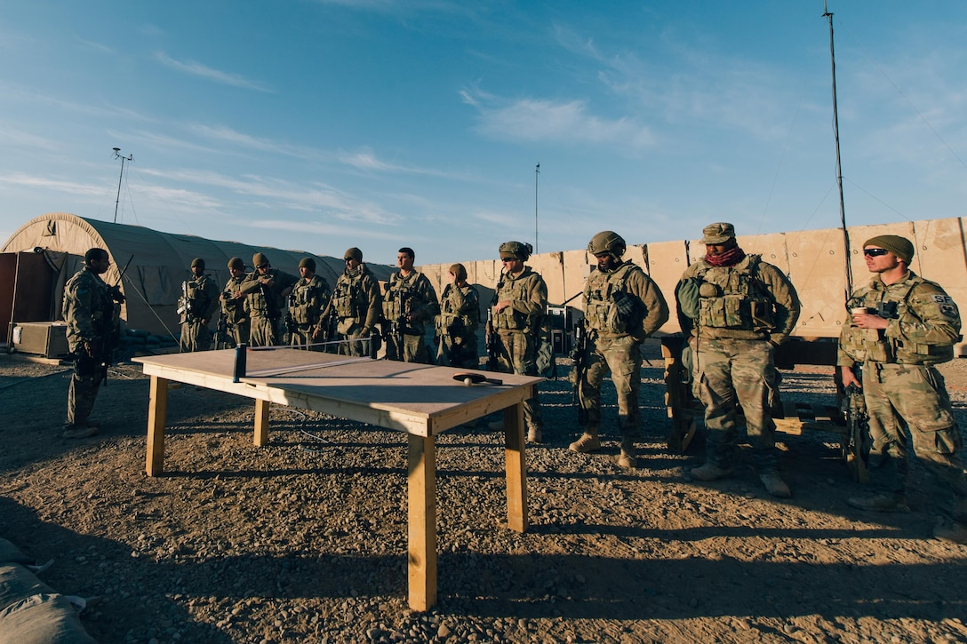 Air Force Tech. Sgt. Ronald Weaver, left, briefs troops while supporting Operation Inherent Resolve at Qayyarah West Airfield, Iraq, Nov. 19, 2016. Air Force photo by Senior Airman Jordan Castelan