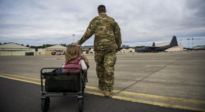 Capt. Mitchell Radigan, a flight doctor with the 1st Special Operations Medical Group, wheels his children to a static display during a Spouses Flight tour at Hurlburt Field, Fla., Nov. 16, 2016. Before the flights began, spouses toured different aircraft static displays to develop a better understanding of the importance of 1st Special Operations Wing mission. (U.S. Air Force photo by Airman 1st Class Isaac O. Guest IV)