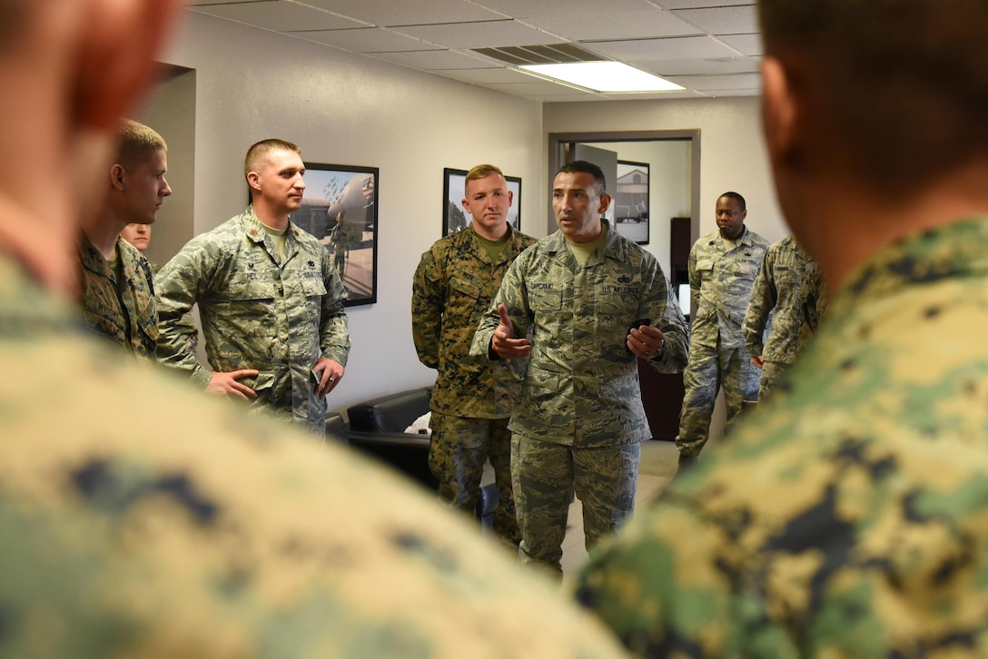 Chief Master Sgt. Marlon Carcamo, 4th Logistics Readiness Squadron chief enlisted manager, talks to Marines and Airmen Nov. 17, 2016 Seymour Johnson Air Force Base, North Carolina. Airmen trained Marines in a week-long joint training exercise to familiarize the Marines with the R-11 aircraft refueler before their deployment to Morón Air Base, Spain. (U.S. Air Force photo by Airman 1st Class Kenneth Boyton)