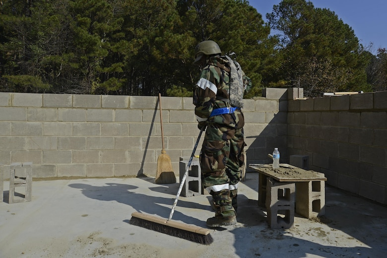 U.S. Air Force Senior Airman Rashon Reid, 20th Civil Engineer Squadron structural journeyman, sweeps away leftover mortar at Shaw Air Force Base, S.C., Nov. 16, 2016. Mortar is the substance that keeps a brick structure together. (U.S. Air Force photo by Airman 1st Class BrieAnna Stillman)