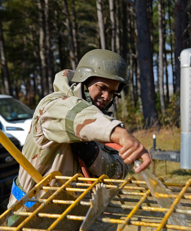 U.S. Air Force Senior Airman Jeff Snead, Jr., 20th Civil Engineer Squadron structural journeyman, adds water to sand and minerals to make mortar at Shaw Air Force Base, S.C., Nov. 16, 2016. During operational readiness exercise Weasel Victory 17-03, Airmen continued normal operations while adhering to Mission Oriented Protective Posture levels. (U.S. Air Force photo by Airman 1st Class BrieAnna Stillman)