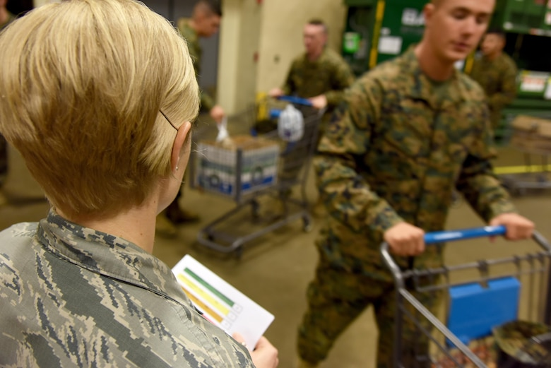U.S. Air Force Master Sgt. Brenda Dodson, 315th Training Squadron first sergeant, tracks the number of boxes each squadron gets for Operation Warmheart inside the commissary on Goodfellow Air Force Base, Texas, Nov. 22, 2016. First sergeants signed up service members to received free Thanksgiving items such as turkey and powdered mashed potatoes, which they later distributed. (U.S. Air Force photo by Senior Airman Joshua Edwards/Released)