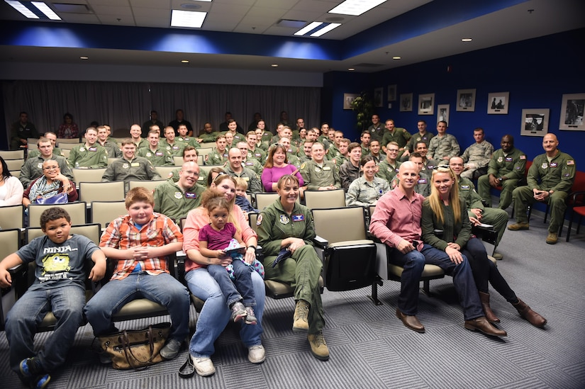 Brett Gardner, New York Yankees outfielder, and his wife, Jessica, both bottom right, sit with the members of the 15th Airlift Squadron Nov. 21, 2016. Gardner visited Joint Base Charleston to boost morale and offer thanks to the military men and women who are serving. Gardner and his wife toured the inside a C-17 Globemaster III and, later, hosted an early Thanksgiving catered potluck event for the squadron.
