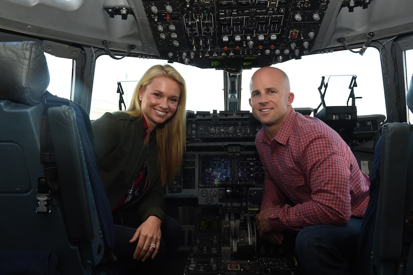 Brett Gardner, New York Yankees outfielder, right, and his wife, Jessica, left, sit in the cockpit of a C-17 Globemaster III on the flightline at Joint Base Charleston, Nov. 21, 2016.  Gardner is a Charleston native who lives here during his off-season from baseball. Gardner visited Joint Base Charleston to boost morale and offer thanks to military men and women who are serving. Gardner and his wife toured a C-17 Globemaster III and provided lunch for the squadron.