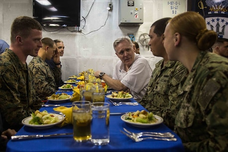 USS MAKIN ISLAND, Singapore (November 22, 2016) The Honorable Mr. Ray Mabus, The Secretary of the Navy, speaks with Marines and Sailors of the Makin Island Amphibious Ready Group/11th Marine Expeditionary Unit during a meal as part of his visit to the USS Makin Island (LHD 8), moored at Changi Naval Base, Singapore, Nov. 22, 2016. Mabus visited the ship following the MKI ARG/11th MEU's port call to Singapore, prior to the ARG/MEU resuming its transit to Central Command's areas of operation. (U.S. Marine Corps photo by Cpl. Devan K. Gowans/Released)