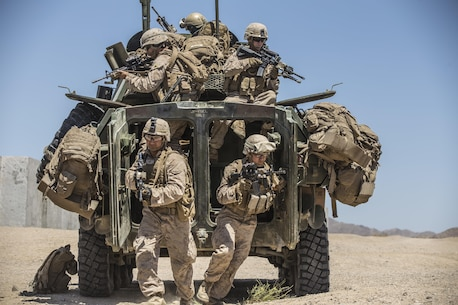 Marines dismount from a Light Armored Reconnaissance Vehicle to raid a compound during the 11th Marine Expeditionary Unit's Combined Arms Exercise at Marine Corps Air Ground Combat Center Twentynine Palms, Calif., June 12, 2016. Well-planned and aggressive training like this prepares the individual Marine to fulfill their role on the team, which in turn builds unit cohesion and increases the speed of mission accomplishment. MEUCAX is conducted to maintain a high level of combat readiness prior to the MEU's Western Pacific 16-2 deployment later this year. The Marines are with LAR Company, Battalion Landing Team 1st Bn., 4th Marines, 11th MEU. (U.S. Marine Corps photo by Lance Cpl. Zachery Laning/Released)