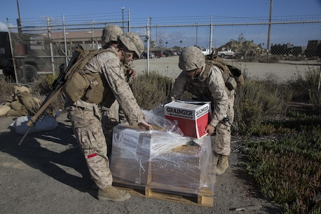 CAMP PENDLETON, Calif. (September 13, 2016) – Marines and sailors with Combat Logistics Detachment 113, Combat Logistics Battalion 11, 11th Marine Expeditionary Unit, carry boxes of food for a Foreign Humanitarian Assistance training mission during the Makin Island Amphibious Ready Group/11th MEU's Certification Exercise Sept. 13, 2016. An FHA can include provision of food water, clothing, beds and bedding, temporary shelter and housing, medical material, medical and technical services, and essential service restoration. CERTEX is the last exercise in the MEU's six-month pre-deployment training cycle in which the ARG/MEU team will be tested then certified as deployable prior to their WestPac 16-2 deployment to the Western Pacific and Central commands' areas of operations. (US Marine Corps photo by Cpl. April L. Price/Released)