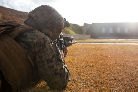 MARINE CORPS BASE HAWAII – KANEOHE BAY, Hawaii (October 21, 2016) - A Marine fires an M4A1 at targets during the 11th Marine Expeditionary Unit's sustainment exercise aboard Marine Corps Base Kaneohe Bay, Hawaii, Oct. 21, 2016.  Marines with Company C, Battalion Landing Team 1st Battalion, 4th Marines, conducted battle sight zero on their weapons to align their optics for ranges later in the day. (U.S. Marine Corps photo by Lance Cpl. Brandon Maldonado)