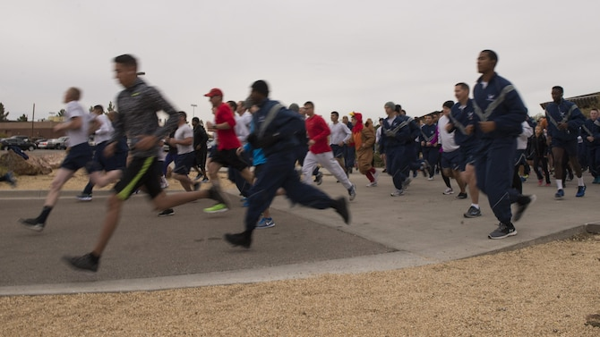 Participants race in the 49th Force Support Squadron's annual Turkey Trot on Nov. 21, 2016 at Holloman Air Force Base, N.M. 150 Airmen and their families competed in the race. (U.S. Air Force photo by Airman 1st Class Alexis P. Docherty)