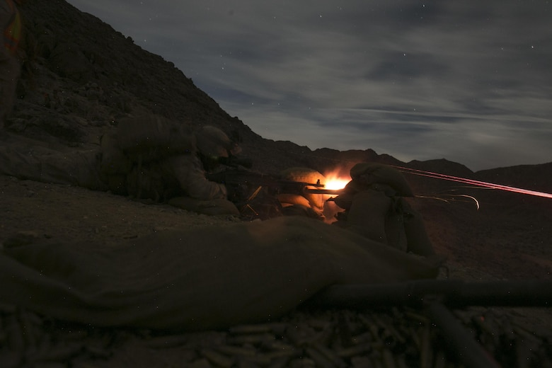Machine gunners with 1st Battalion, 7th Marine Regiment, fire an M240B medium machine gun at a target at Range 400 aboard Marine Corps Air Ground Combat Center, Twentynine Palms, Calif., during the unit's night-time combined arms live-fire exercise Nov. 16, 2016. (Official Marine Corps photo by Cpl. Julio McGraw/Released)