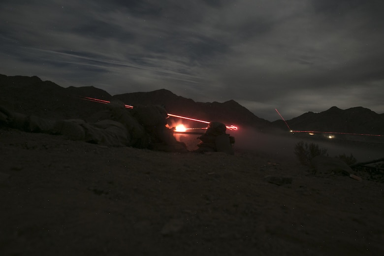 Marines with 1st Battalion, 7th Marine Regiment, fire an M240B medium machine gun at a target at Range 400 aboard Marine Corps Air Ground Combat Center, Twentynine Palms, Calif., during the unit's night-time combined arms live-fire exercise Nov. 16, 2016. (Official Marine Corps photo by Cpl. Julio McGraw/Released)