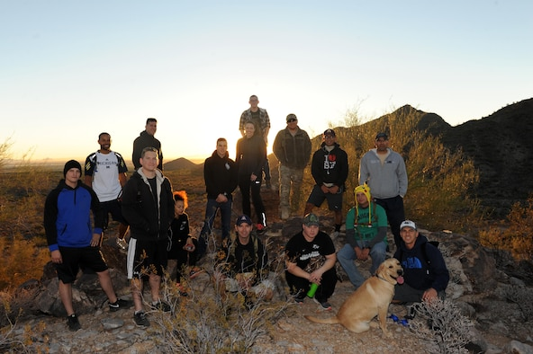 The 56th Maintenance Group maintenance operations staff rests atop the Verrado trailhead Nov. 18, 2016 at the White Tank Mountains. The hike was directed to improve morale and leadership. (U.S. Air Force photo by Airman 1st Class Pedro Mota)