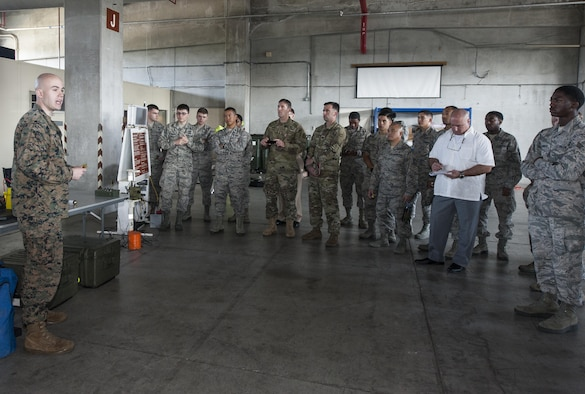 U.S. Marine Corps Lance Cpl. James Dietrich, Third Marine Division Headquarters Battalion Chemical, Biological, Radiological and Nuclear platoon, talks about the different CBRN equipment Marines utilize during the CBRN Exposition Nov. 17, 2016, at Kadena Air Base, Japan. Chemical, Biological, Radiological and Nuclear specialists from across the island of Okinawa come together for the CBRN Exposition. (U.S. Air Force photo by Senior Airman Lynette M. Rolen/Released)