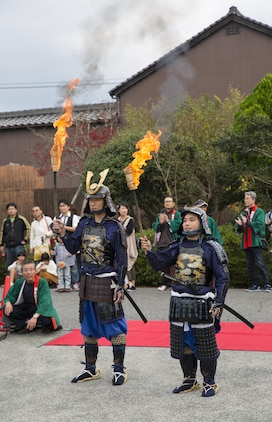 Two samurai wait to be called to light the torches at the 27th annual Kuragake Festival and Samurai Parade in Iwakuni City, Japan, Nov. 20, 2016. To commemorate the great battle of faith in 1555, Iwakuni City holds an annual festival and parade of samurai warriors. (U.S. Marine Corps photo by Sgt. Nicole Zurbrugg)