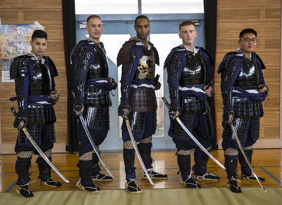 U.S. Marines from Marine Corps Air Station Iwakuni pose for a picture at the 27th annual Kuragake Festival and Samurai Parade in Iwakuni City, Japan, Nov. 20, 2016. The Marines were transformed from service members to samurai warroirs with traditional samurai armor, swords, spears and helmets before marching down the streets of Kuga demonstrating their strength and courage before going to battle. (U.S. Marine Corps photo by Sgt. Nicole Zurbrugg)