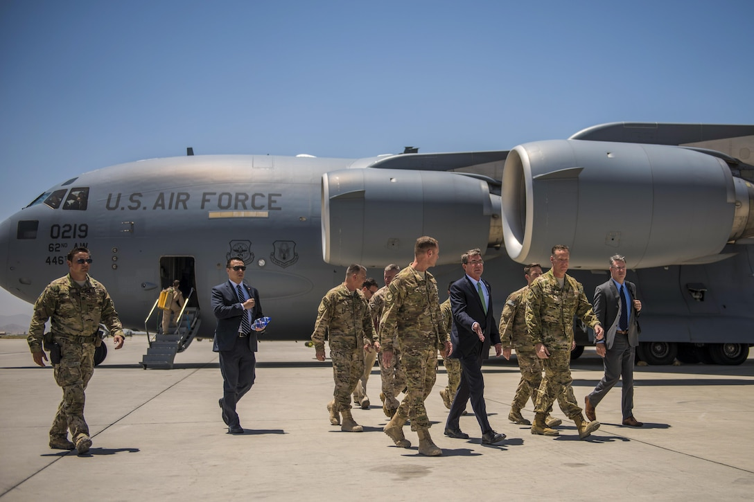 Defense Secretary Ash Carter walks with leaders at Bagram Airfield, Afghanistan, July 12, 2016. Carter discussed the U.S. role in performing both counterterrorism operations and training, advising, and assisting Afghan military forces. Air Force photo by Senior Airman Justyn M. Freeman