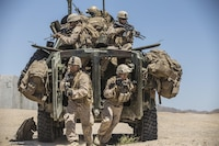Marines dismount from a Light Armored Reconnaissance Vehicle to raid a compound during the 11th Marine Expeditionary Unit's Combined Arms Exercise at Marine Corps Air Ground Combat Center Twentynine Palms, Calif., June 12, 2016. Well-planned and aggressive training like this prepares the individual Marine to fulfill their role on the team, which in turn builds unit cohesion and increases the speed of mission accomplishment. MEUCAX is conducted to maintain a high level of combat readiness prior to the MEU's Western Pacific 16-2 deployment later this year.