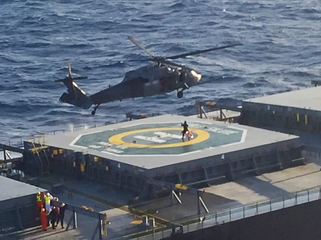 An HH-60G Pavehawk rescue helicopter and it's crew, 129th Rescue Wing, California Air National Guard, hovers over a Japanese bulk carrier vessel, Noble Salute during a long distance rescue over the Pacific Ocean, Nov. 19, 2016.  The mission was to save the life of a seriously ill 29-year-old Filipino man on board Noble Salute.  (Courtesy photo by Maj. Nathan Nowaski/released)