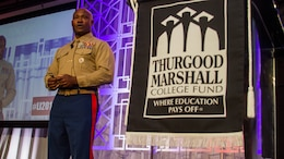 Colonel Anthony M. Henderson speaks to an audience at a morning plenary during the Thurgood Marshall College Fund Leadership Institute at the Washington Hilton, Nov. 21, 2016. Marines host events, including workouts and workshops for the TMCF as a way to give back to the community and shape diverse young leaders. Hundreds of students from around the United States gather for the TMCF for the opportunity to learn from experienced men and women who rose from the same cultural backgrounds.