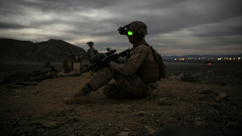 Cpl. Ryan Weston, squad leader, 1st Battalion, 7th Marine Regiment, looks down Range 400 at Marine Corps Air Ground Combat Center, Twentynine Palms, California, during the unit's night-time combined arms live-fire exercise Nov. 16, 2016.
