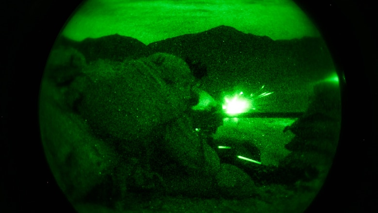 Lance Cpl. Zach Frankley and Pfc. Kervin Jean-Claude, machine gunners, 1st Battalion, 7th Marine Regiment, fire at a target at Range 400 at Marine Corps Air Ground Combat Center Twentynine Palms, California, during the unit's night-time combined arms live-fire exercise Nov. 16, 2016.
