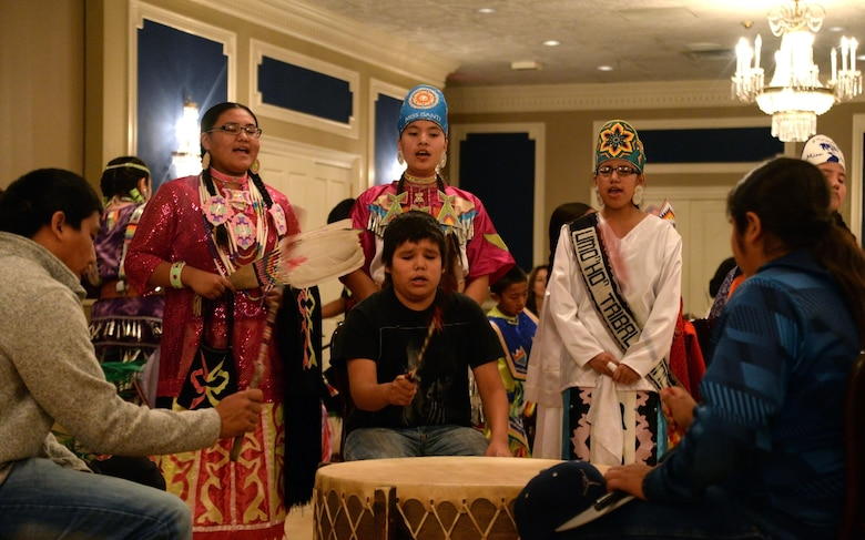 Members of the Omaha Tribe sing and play drum during the Offutt Diversity Team's National American Indian Heritage Month Nov. 15 at the Patriot Club. The tribe performed more than 30 minutes of song and dance for members of Team Offutt. (U.S. Air Force photo/Josh Plueger)