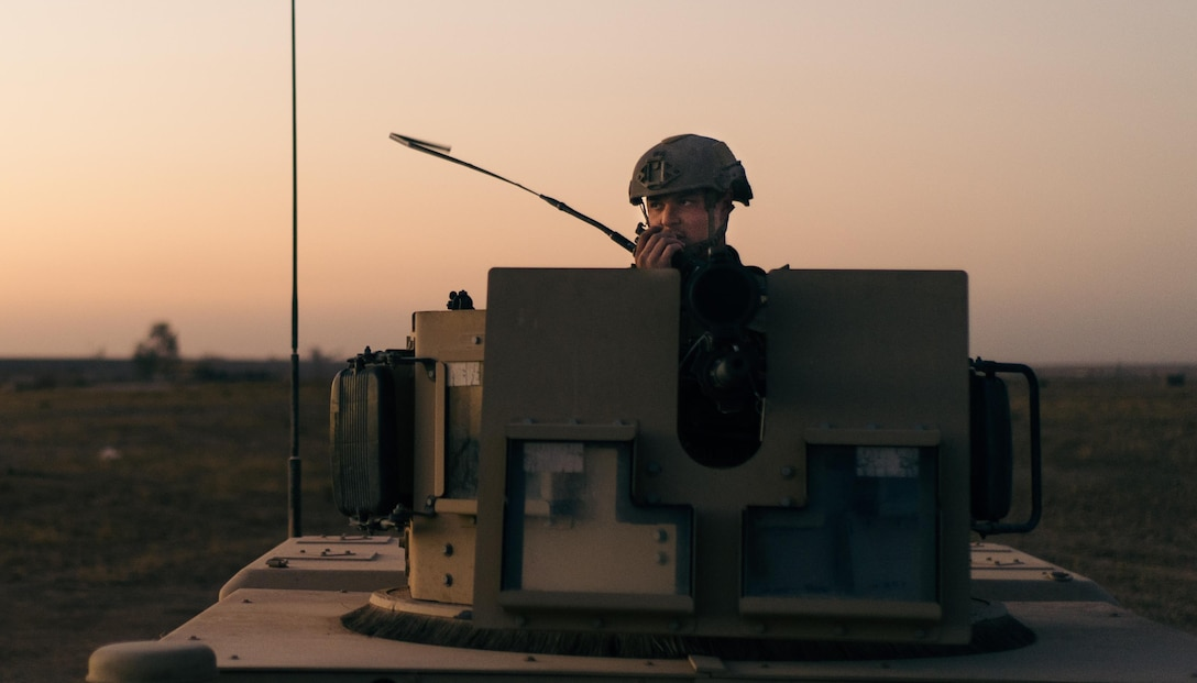 Senior Airman Anthony Wachob, a member of the 821st Contingency Response Group, radios in from a defensive fighting position while on perimeter watch at Qayyarah West Airfield, Iraq, Nov. 17, 2016. The 821st CRG is highly specialized in training and rapidly deploying personnel to quickly open airfields and establish, expand, sustain and coordinate air mobility operations in austere, bare-base conditions. (U.S. Air Force photo/Senior Airman Jordan Castelan)