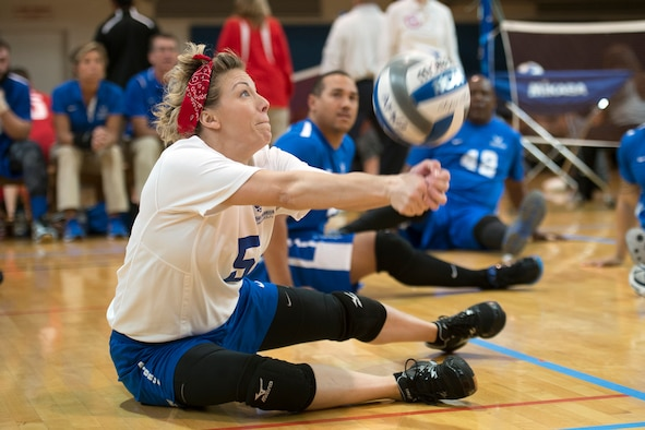 Tech Sgt. Jessica Moore bumps a serve during the 2016 Warrior CARE Month Joint Service Sitting Volleyball Tournament at the Pentagon Nov. 19, 2016. (Department of Defense photo/EJ Hersom)
