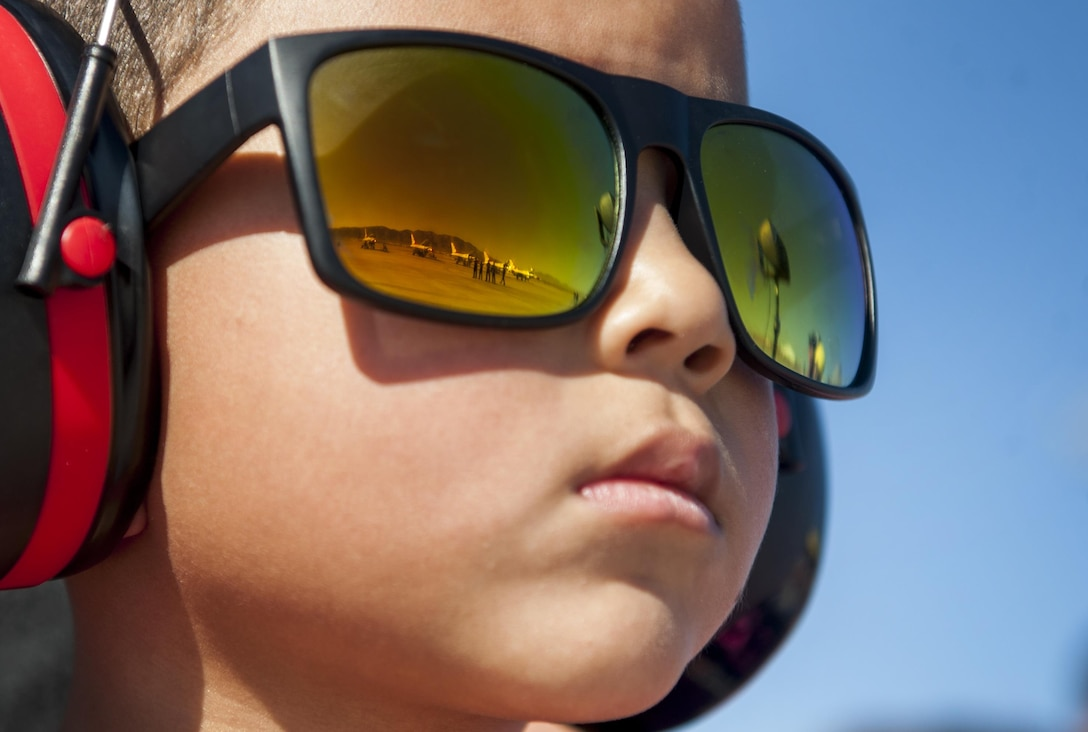 """A boy watches the Thunderbirds prepare for takeoff during the Aviation Nation Air Show on Nellis Air Force Base, Nev., Nov. 11, 2016. The air show brought more than 300,000 spectators from across the globe to experience """"75 years of airpower."""" (U.S. Air Force photo/Airman 1st Class Kevin Tanenbaum)"""