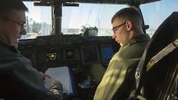Jon Ayers discusses the cockpit armament controls in a V-22 Osprey with Lance Cpl. Jared Wooten while assessing the aircraft's onboard systems and tactical aircraft protection system at Marine Corps Air Station New River, N.C., Nov. 17, 2016. Marine Medium Tilitrotor Squadron 365 (Reinforced) underwent the assessment to prepare for their upcoming deployment with the 24th Marine Expeditionary Unit. Ayers is a ALE -47 program Navy Logistician with the fleet support team. Wooten serves as a V-22 Osprey avionics technician with the unit.